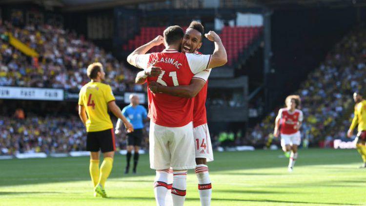 Aubameyang merayakan gol di laga Watford vs Arsenal pada pekan ke-5 Liga Inggris 2019/20, Minggu (15/09/19) WIB, di Vicarage Road. Copyright: © Twitter/@premierleague