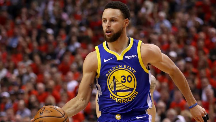 Stephen Curry, pemain basket Golden State Warriors dan Timnas AS. Copyright: © Gregory Shamus/Getty Images