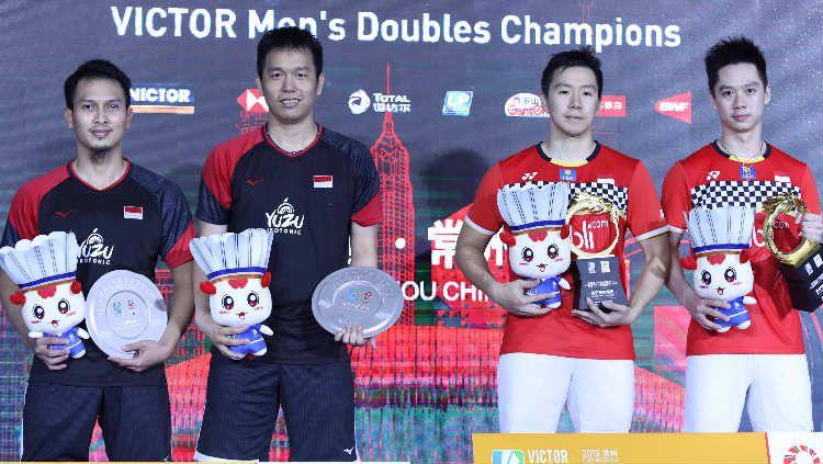 Kevin Sanjaya Sukamuljo/Marcus Fernaldi Gideon dan Mohammad Ahsan/Hendra Setiawan di podium China Open 2019. Copyright: © PBSI