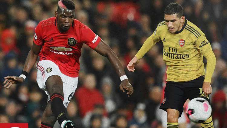 Situasi perebutan bola di laga Manchester United vs Arsenal Copyright: © Twitter Manchester United