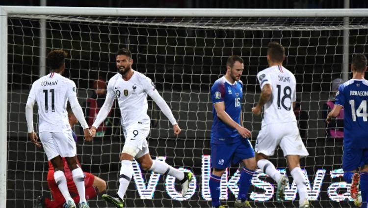Olivier Giroud saat merayakan gol di pertandingan Kualifikasi Euro 2020 antara Islandia vs Prancis pada Sabtu (12/10/19) dini hari WIB. Copyright: © uefa.com