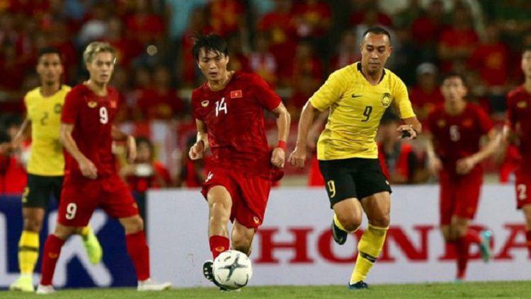 Gelandang Timnas Vietnam, Nguyen Tuan Anh, ditawari bergabung ke tim LaLiga Spanyol, Deportivo Alaves, sehingga ia bisa ikuti jejak rekan setim, Doan Van Hau. Copyright: © Bongda.vn