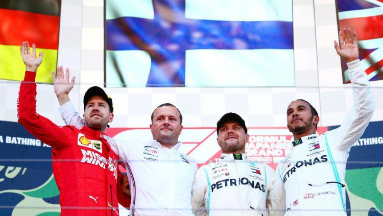 Podium F1 GP Jepang: Sebastian Vettel, Valtteri Bottas, dan Lewis Hamilton. Copyright: © Dan Istitene/Getty Images