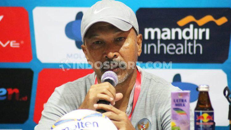 Pelatih Timnas Indonesia U-19, Fakhri Husaini. Foto: Nofik Lukman Hakim/INDOSPORT Copyright: © Nofik Lukman Hakim/INDOSPORT