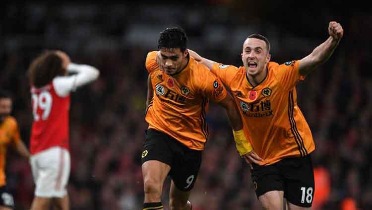 Raul Jimenez, Adama Traore dan Diego Jota menjadi pemain Wolves yang paling harus diwaspadai Liverpool di pekan ke-20 liga Inggris. Copyright: © Sam Bagnall - AMA/Getty Images