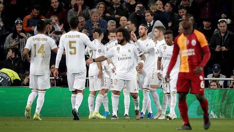 Aksi selebrasi pemain Real Madrid menang banyak atas Galatasaray pada laga Liga Champions games ke-4 di Santiago Bernabeu Stadium. Copyright: © Burak Akbulut/Anadolu Agency via Getty Images