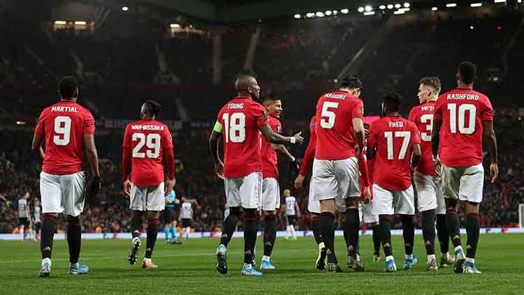 Aksi selebrasi pemain Manchester United menang 3-0 atas Partizan Copyright: © John Peters/Manchester United via Getty Images