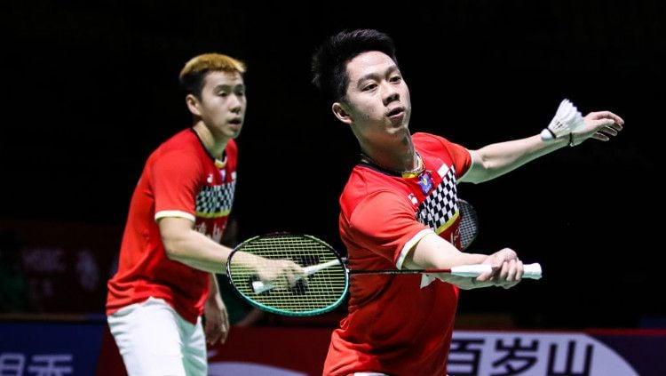 Aksi Kevin Sanjaya bersama Marcus Gideon di final Fuzhou China Open 2019, Minggu (10/11/19). Copyright: © Shi Tang/Getty Images