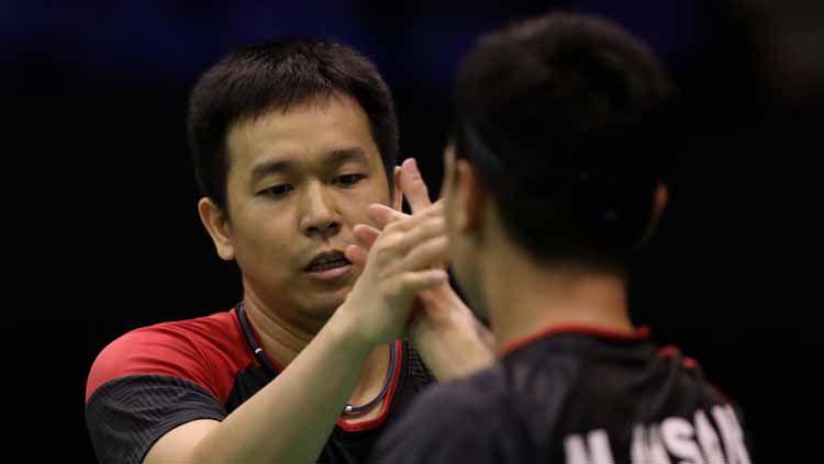 Pebulutangkis ganda campuran, Hendra Setiawan memiliki julukan baru usai tampil memukau di laga perdana BWF World Tour Finals 2019, Rabu (11/12/19) kemarin. Copyright: © https://badmintonindonesia.org/
