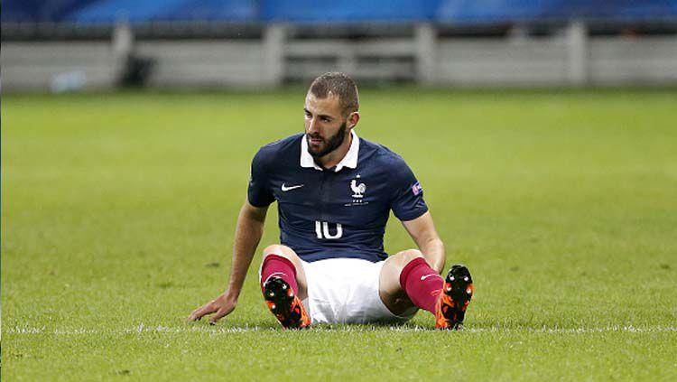 Karim Benzema mengungkapkan keinginan membela negara lain setelah tak lagi dilirik oleh Timnas Prancis. Copyright: © Jean Catuffe/GettyImages