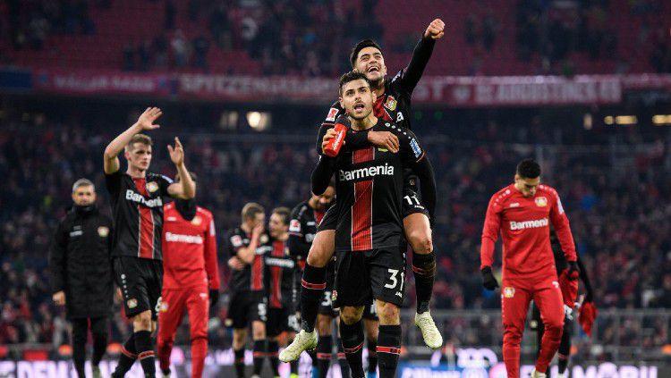 Selebrasi pemain Bayer Leverkusen saat mampu meraih kemenangan atas Bayern Munchen di pekan ke-13 Bundesliga Jerman, Minggu (01/12/19). Copyright: © https://twitter.com/bayer04_en