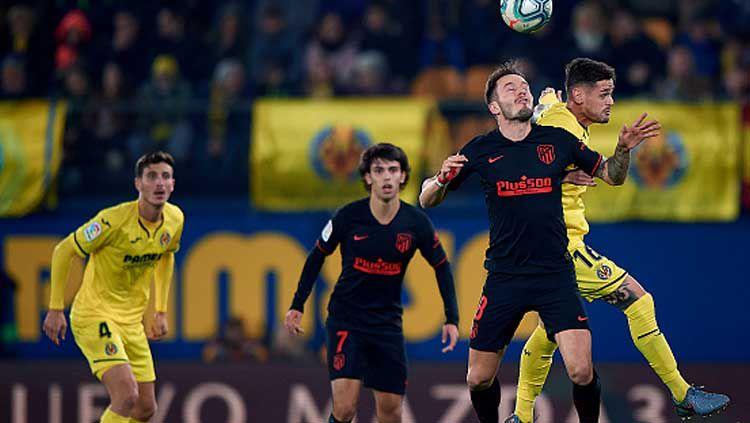 Duel pemain Villarreal vs Atletico Madrid dalam laga LaLiga Spanyol 2019-2020 pekan ke-16 Copyright: © Pablo Morano/GettyImages