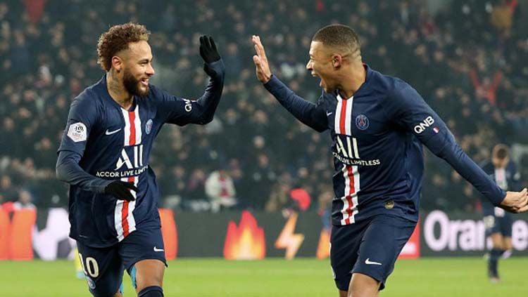 Dua pemain bintang PSG, Neymar (kiri) dan Kylian Mbappe selamatkan timnya dari kekalahan saat melawan Montpellier pada pertandingan Ligue 1 2019-2020 pekan ke-16. Copyright: © Xavier Laine/Getty Images