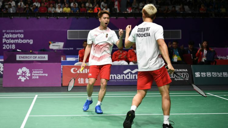 Kevin/Marcus akan lebih bersiap dan fokus agar dapat mengatur tenaga di laga melawan Hiroyuki Endo/Yuta Watanabe pada semifinal BWF World Tour Finals 2019. Copyright: © Robertus Pudyanto/Getty Images