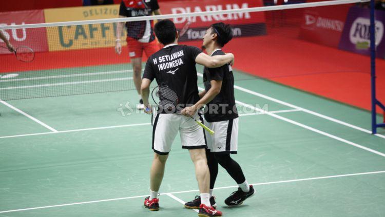 Pasangan Mohammad Ahsan/Hendra Setiawan menyebut peran dari sosok-sosok ini usai memenangkan 'perang saudara' di semifinal Indonesia Masters 2020. Copyright: © Herry Ibrahim/INDOSPORT