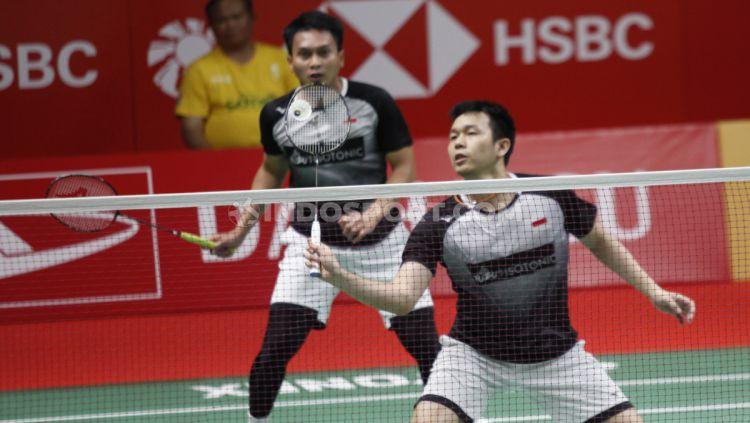 Inilah momen saat pasangan Mohammad Ahsan/Hendra Setiawan sukses permalukan duet Lee Yong-dae/ Yoo Yeon-seong di final Asian Games 2014. Copyright: © Herry Ibrahim/INDOSPORT