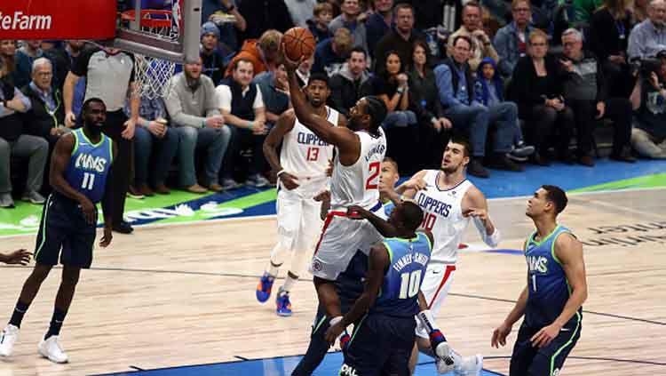 LA Clippers vs Dallas Mavericks di pertandingan NBA 2019-2020 pada bulan November lalu Copyright: © Ronald Martinez/GettyImages