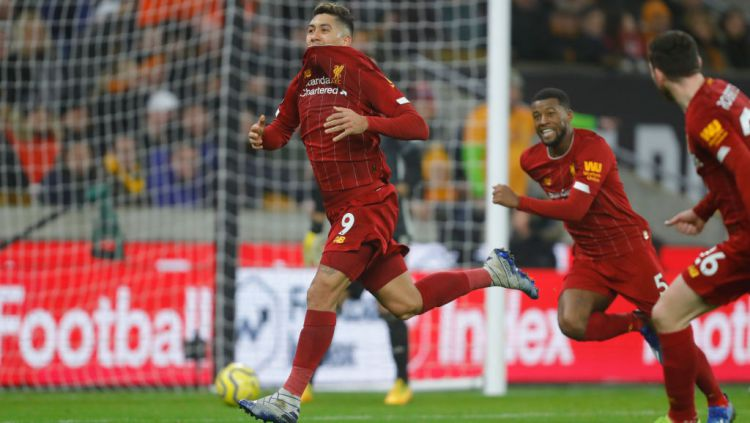 Roberto Firmino merayakan gol yang ia cetak di laga Liga Primer Inggris antara Wolves vs Liverpool Copyright: © James Baylis - AMA/Getty Images