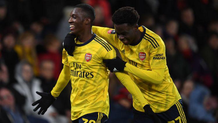 Dua pemain muda Arsenal, Eddie Nketiah dan Bukayo Saka saat melawan Bournemouth di Piala FA. Copyright: © David Price/Arsenal FC via Getty Images