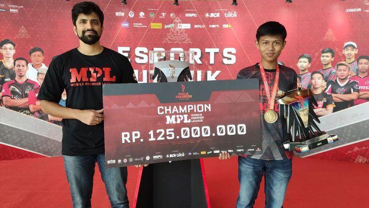 Aby Ramadhan gamer asal Rawamangun, Jakarta Timur berhasil menjadi juara pertama Turnamen MPL di Piala Presiden eSports 2020. Copyright: © Piala Presiden eSports