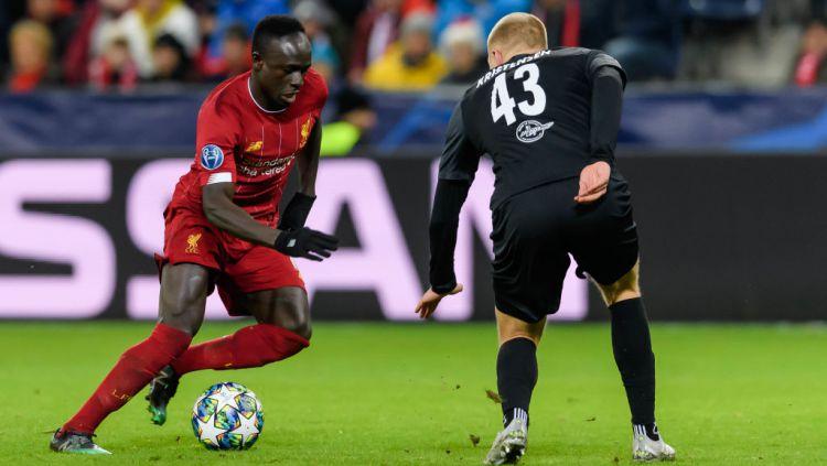 Kisah hidup bintang Liverpool, Sadio Mane bisa disaksikan melalui film dokumenter yang berjudul Sadio Mane: Made In Senegal. Copyright: © TF-Images/Getty Images