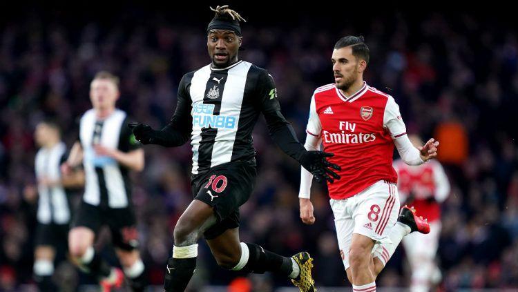 Indosport - Suasana pertandingan Newcastle United vs Arsenal.