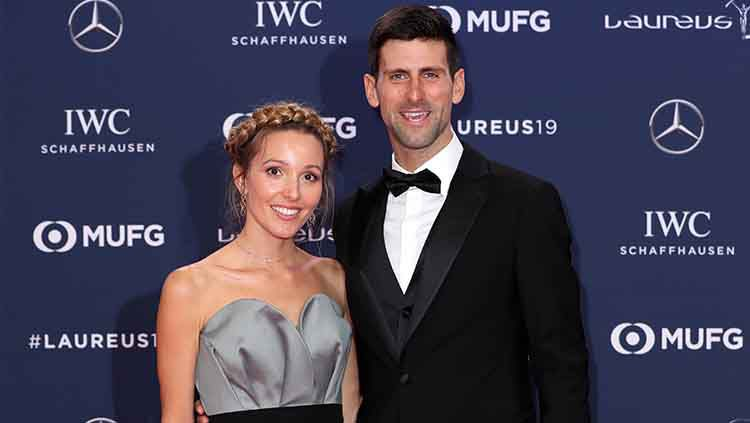 Novak Djokovic bersama sang istri, Jelena. Copyright: © Boris Streubel/Getty Images for Laureus