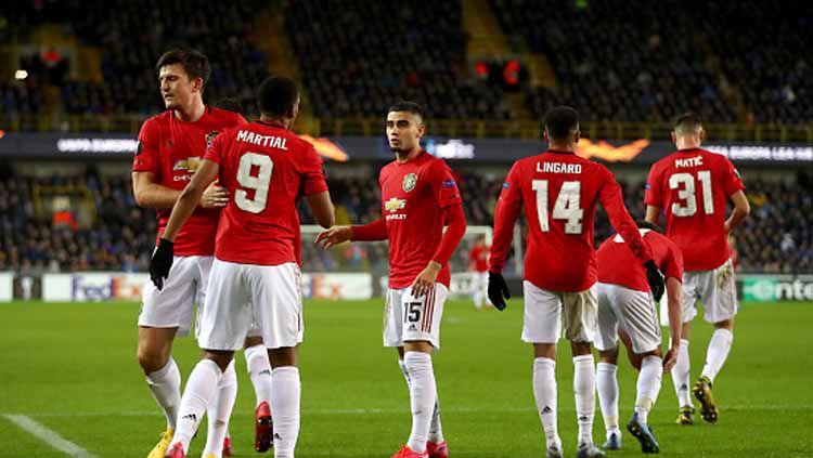 Selebrasi Manchester United di babak 32 besar Liga Europa 2019-2020 saat melawan Club Brugge Copyright: © Dean Mouhtaropoulos/Getty Images