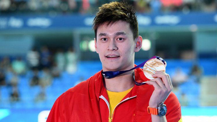 Sun Yang, perenang China saat dapat medali emas di kejuaraan dunia FINA 2019. Copyright: © Quinn Rooney/Getty Images