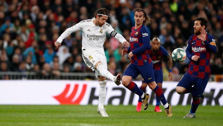 Sergio Ramos tak akan ikut serta bela Real Madrid di laga LaLiga Spanyol kontra Barcelona. Copyright: © twitter.com/realmadrid