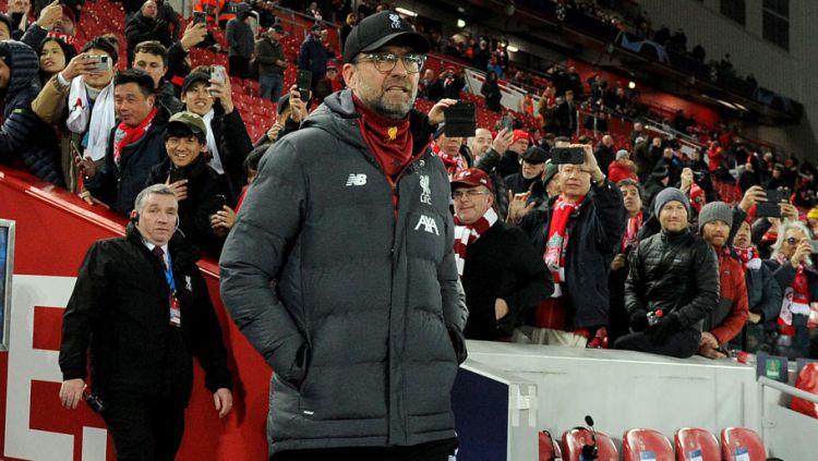 Jurgen Klopp mempertanyakan aturan Liga Inggris dan ingin seluruh pemain Liverpool mendapat medali juara. Copyright: © Andrew Powell/Liverpool FC via Getty Images