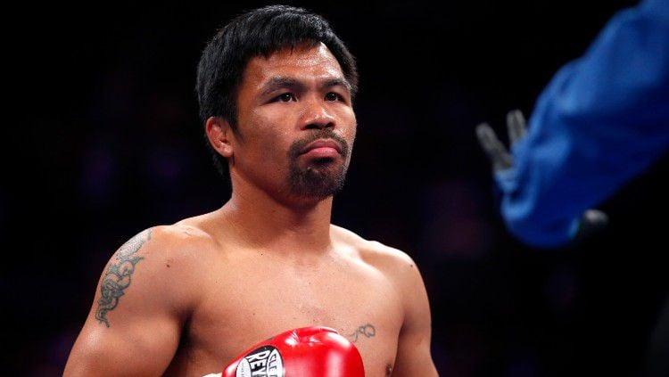 Manny Pacquiao dalam pertarungan melawan Keith Thurman. Copyright: © Steve Marcus/Getty Images