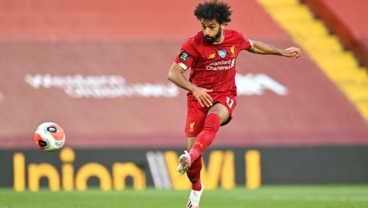 Predator andalan Liverpool, Mohamed Salah, masih kokoh di daftar puncak top skor sementara Liga Inggris 2020/21 ini. Copyright: © Paul Ellis/Pool via Getty Images