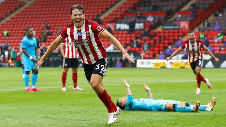 Selebrasi gol Sander Berge di laga Sheffield United vs Tottenham Hotspur. Copyright: © Jason Cairnduff/Pool via Getty Images