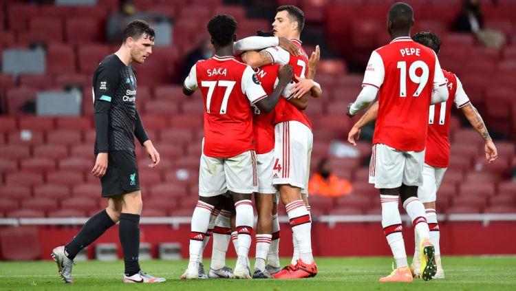 Skuat Arsenal selebrasi usai mengalahkan Liverpool Copyright: © Glyn Kirk/Pool via Getty Images