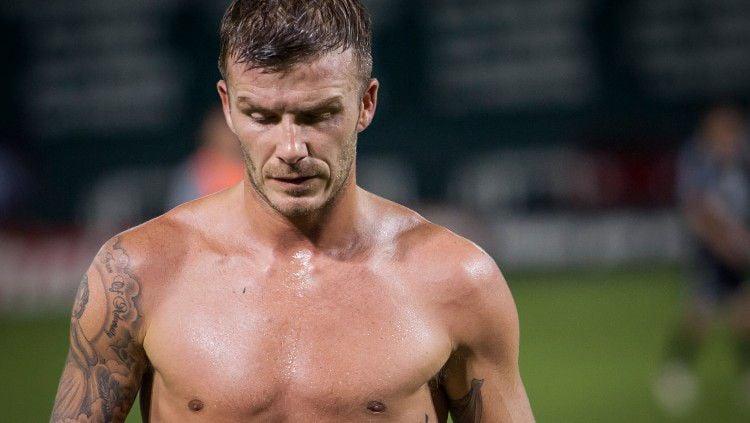 David Beckham dikenal memiliki body atletis dan wajah tampan. Copyright: © Black/Corbis via Getty Images