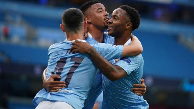 Manchester City sukses kandaskan Real Madrid dan melaju ke perempatfinal Liga Champions usai menang dengan agregat skor 4-2. Copyright: © Dave Thompson/Pool via Getty Images