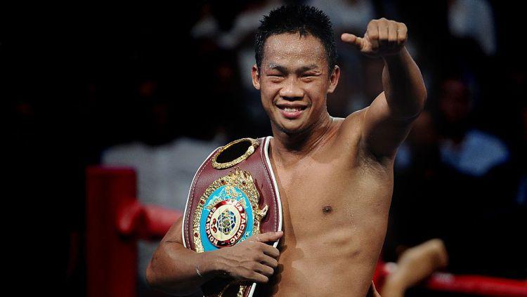 Daud Yordan dengan sabuk gelar juara WBO Asia Pacific Lightweight Championship Copyright: © Robertus Pudyanto/Getty Images