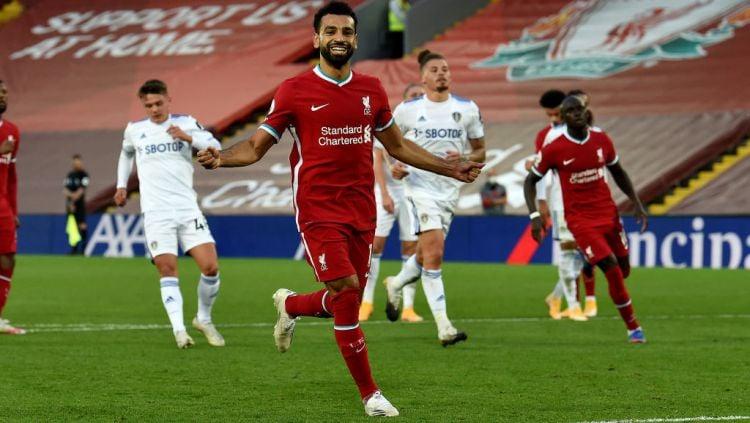 Selebrasi bintang Liverpool, Mohamed Salah usai mencetak gol ke gawang Leeds United Copyright: © John Powell/Liverpool FC via Getty Images