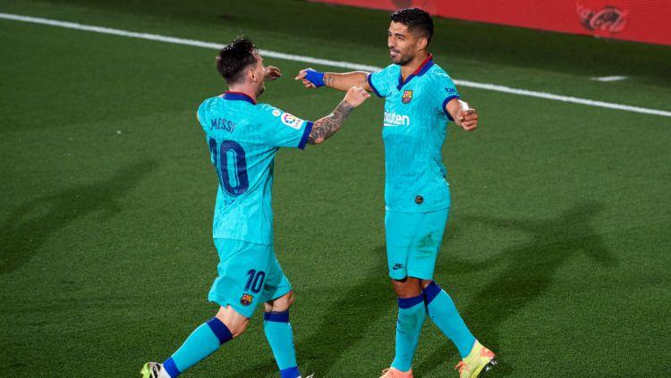 Lionel Messi dan Luis Suarez saat masih menjadi duet maut di Barcelona. Copyright: © Alex Caparros/Getty Images