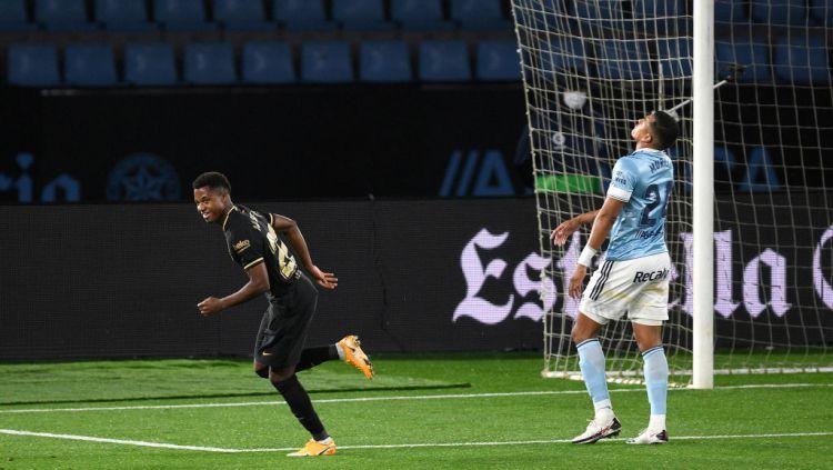 Wonderkid Barcelona, Ansu Fati, berselebrasi usai mencetak gol ke gawang Celta Vigo Copyright: © Octavio Passos/Getty Images