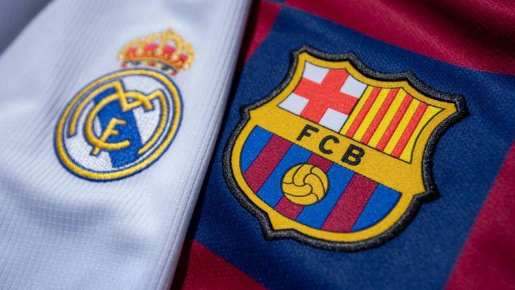 Dua raksasa LaLiga Spanyol, Barcelona dan Real Madrid punya nasib yang serupa di awal bergulirnya kompetisi musim 2020/21. Copyright: © Visionhaus via Getty Images