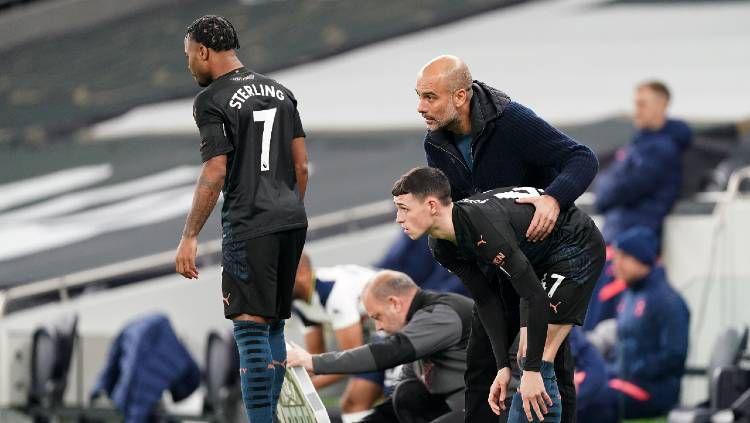 Dibuang Manchester City dan Pep Guardiola, Raheem Sterling buka kans gabung Barcelona pada bursa transfer. Copyright: © Matt McNulty/Manchester City FC via Getty Images