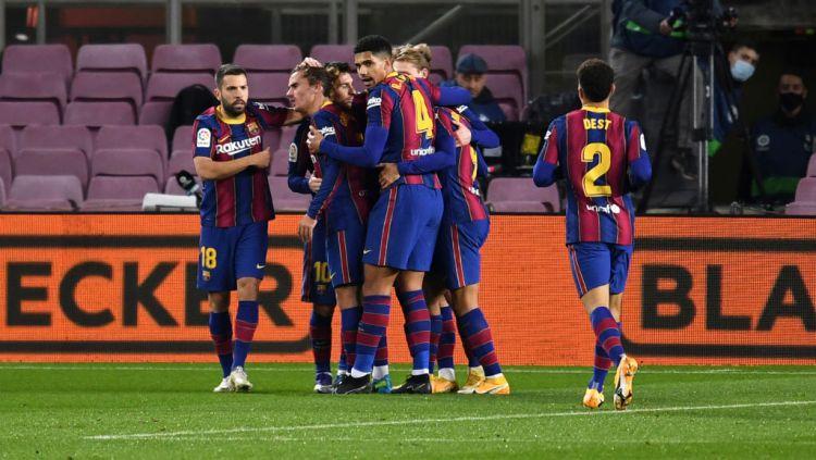 Lionel Messi selebrasi usai cetak gol dalam laga Barcelona vs Levante Copyright: © David Ramos/Getty Images