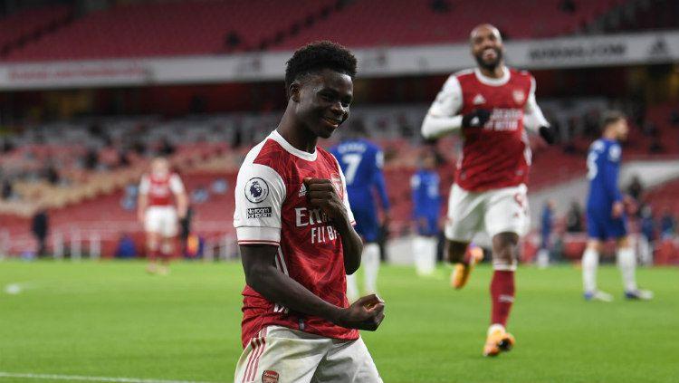 Selebrasi gol Bukayo Saka di laga Arsenal vs Chelsea. Copyright: © David Price/Arsenal FC via Getty Images