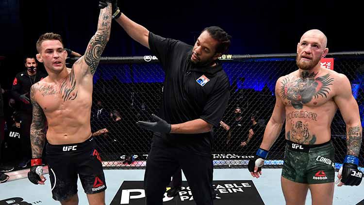 Kemenangan dustin poirier atas conor mcgregor di UFC 257. Copyright: © Jeff Bottari/Zuffa LLC/Getty Images