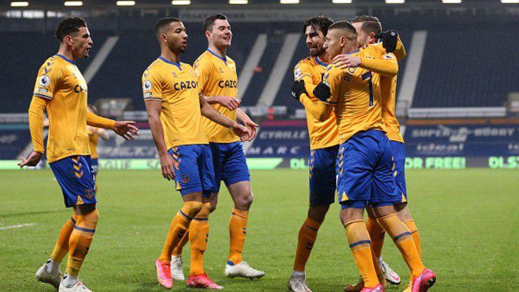 Selebrasi Richarlison yang mencetak satu-satunya gol kemenangan untuk Everton. Copyright: © (Photo by Alex Pantling/Getty Images)