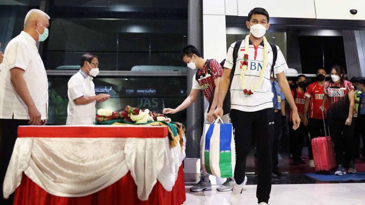 Para pemain bulutangkis Indonesia yang turun di All England 2021 tiba di Tanah Air pada Senin (22/3/2021) malam. Copyright: © PBSI