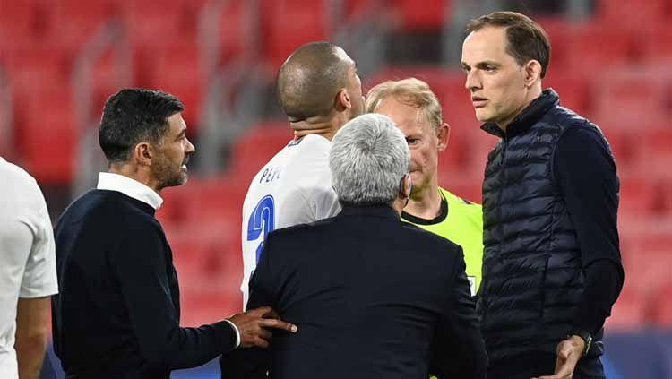 Thomas Tuchel terlibat pertengkaran kecil dengan pelatih Porto di Liga Champions. Copyright: © Getty Images