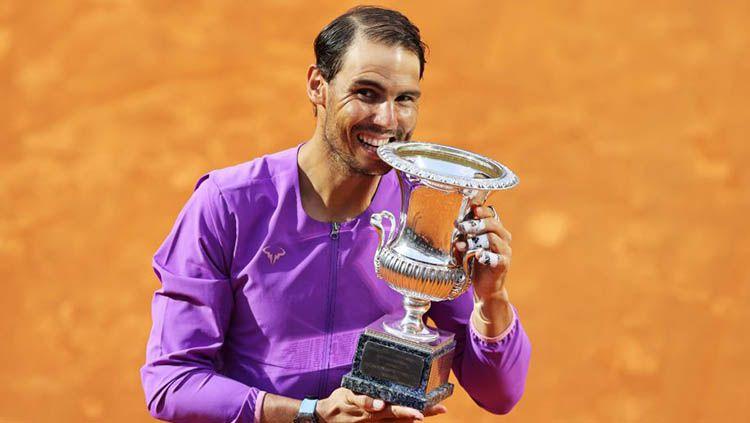 Petenis Rafael Nadal selangkah lagi mendekati rekor milik Roger Federer setelah berhasil melaju ke semifinal Prancis Terbuka 2021 menghadapi Novak Djokovic. Copyright: © Clive Brunskill/Getty Images